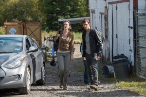 "HAVEN -- ""Power"" Episode 515 -- Pictured: (l-r) Laura Mennell as Dr. Erin Reid, Lucas Bryant as Nathan Wuornos -- (Photo by: Mike Tompkins/Haven 5 Productions/Syfy)"